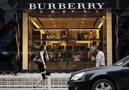 Women walk past a Burberry shop in Beijing, July 11, 2012. REUTERS/Jason Lee