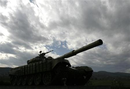 A Soviet-made tank is seen near the town of Agdam, controlled by Nagorno Karabakh, and which was completely destroyed during fighting between Karabakh and Azerbaijan forces in 1990s, October 29, 2009. REUTERS/David Mdzinarishvili