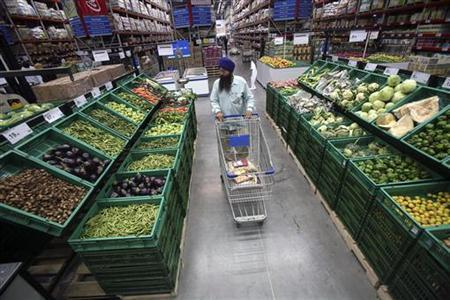 A customer shops at a Best Price Modern Wholesale store, a joint venture of Wal-Mart Stores and Bharti Enterprises, at Zirakpur in the northern Indian state of Punjab May 12, 2010. REUTERS/Ajay Verma
