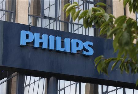 The logo of Philips is seen at the company's entrance in Brussels September 11, 2012. Philips Electronics stepped up its cost-cutting drive on Tuesday and said more jobs would go as part of a drastic overhaul of its business, which began to turn around in the first half after losing 1.3 billion euros in 2011. REUTERS/Francois Lenoir