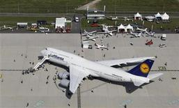 A Lufthansa Boeing 747-8 aircraft is on display during the opening day of ILA Berlin Air Show in Selchow near Schoenefeld south of Berlin, September 11, 2012. REUTERS/Tobias Schwarz (GERMANY - Tags: TRANSPORT TRAVEL BUSINESS)