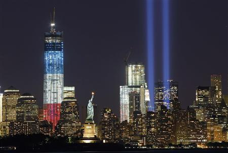 The Tribute in Light is illuminated next to the Statue of Liberty (C) and One World Trade Center (L) during events marking the 11th anniversary of the 9/11 attacks on the World Trade Center in New York, September 10, 2012. REUTERS/Gary Hershorn