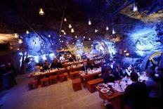 Customers eat their dinner at Muru Pop Down restaurant at Tytyri mine in Lohja, September 10, 2012. REUTERS/Antti Aimo-Koivisto/Lehtikuva