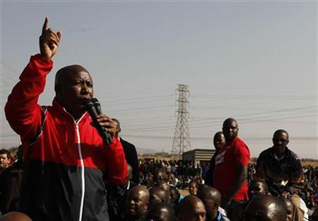 Former African National Congress Youth League (ANCYL) President Julius Malema addresses striking miners outside a South African mine in Rustenburg, 100 km (62 miles) northwest of Johannesburg August 18, 2012. REUTERS/Siphiwe Sibeko
