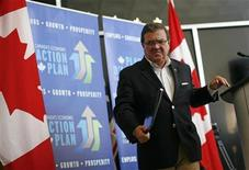 Canada's Finance Minister Jim Flaherty leaves following a news conference in Ottawa August 15, 2012. REUTERS/Chris Wattie