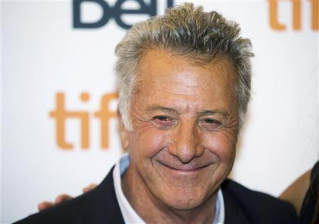 Director Dustin Hoffman arrives on the red carpet for the gala presentation of his film ''Quartet'' at the 37th Toronto International Film Festival, September 9, 2012. REUTERS/Mark Blinch