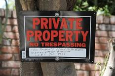 A sign is seen outside the entrance of the Jackson family compound in the Encino area of Los Angeles July 22, 2012. REUTERS/Phil McCarten