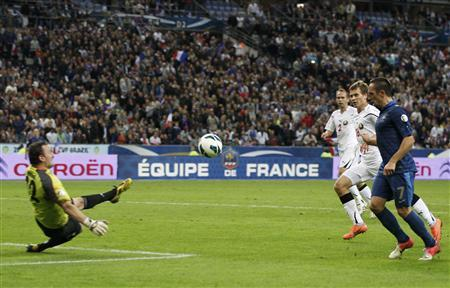 France's Franck Ribery shoots and scores the third goal for the team during their World Cup qualifying soccer match against Belarus in Saint-Denis, near Paris, September 11, 2012. REUTERS/Gonzalo Fuentes