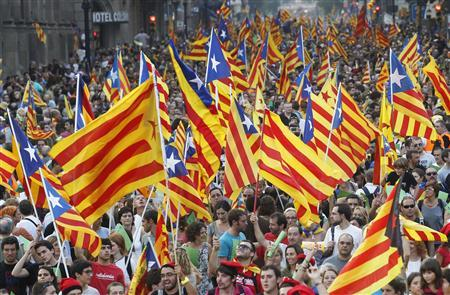 Marchers wave Catalonian nationalist flags as they demonstrate during Catalan National Day in Barcelona September 11, 2012. Demonstrators from across the region, some urging full independence, others calling for more autonomy from Madrid, marched on Tuesday under the slogan ''Catalonia, a new European state.'' REUTERS/Albert Gea