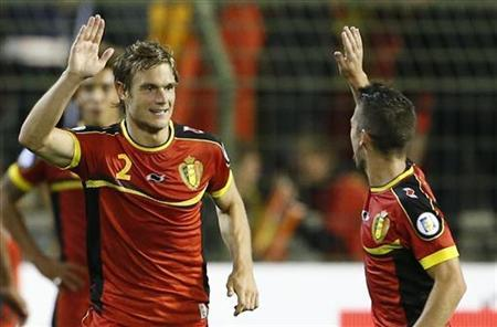 Belgium's Guillaume Gillet (L) celebrates with team mate Dries Mertens (C) after scoring against Croatia during their 2014 World Cup qualifying soccer match at the King Baudouin Stadium in Brussels September 11, 2012. REUTERS/Francois Lenoir