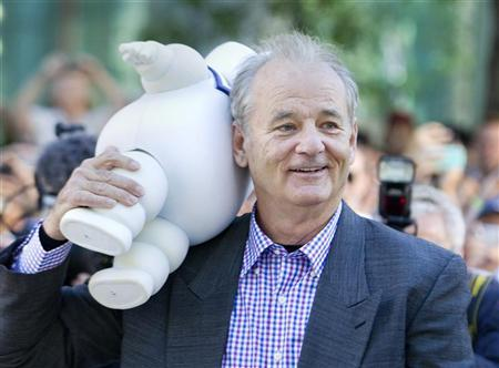 Actor Bill Murray carries a marshmallow doll he received from a fan as he arrives to the gala presentation for the film 'Hyde Park on Hudson' during the 37th Toronto International Film Festival, September 10, 2012. REUTERS/Fred Thornhill