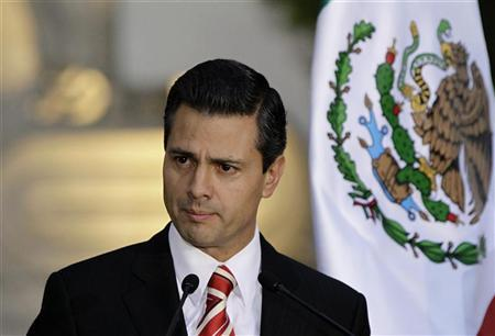 Mexico's President-elect Enrique Pena Nieto speaks to the media next to Mexican President Felipe Calderon (not pitured), after attending a private meeting at Los Pinos Presidential Palace in Mexico City September 5, 2012. REUTERS/Henry Romero