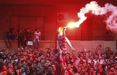 People shout slogans and light flares in front of the U.S. embassy during a protest against what they said was a film being produced in the United States that was insulting to the Prophet Mohammad, in Cairo September 11, 2012. REUTERS/Amr Abdallah Dalsh