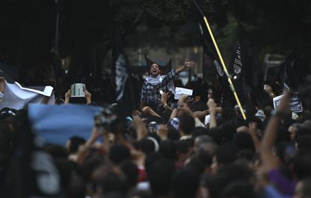 People shout slogans in front of the U.S. embassy during a protest against what they said was a film being produced in the United States that was insulting to the Prophet Mohammad, in Cairo September 11, 2012. REUTERS/Amr Abdallah Dalsh