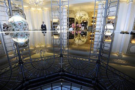 The Thames foyer is seen reflected from a grand piano of the Savoy Hotel in London October 10, 2010. REUTERS/Paul Hackett
