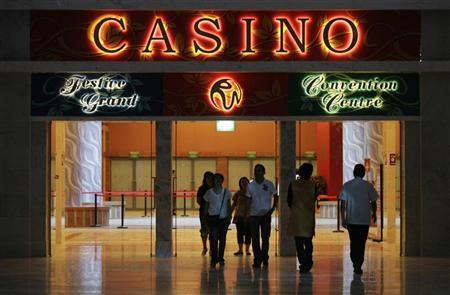 Visitors walk through a lobby at the soon-to-be-opened Resorts World Sentosa casino on Singapore's Sentosa Island February 11, 2010. REUTERS/Vivek Prakash