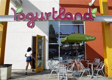 A Yogurtland franchise store is pictured in Los Angeles, California September 10, 2012. Franchising ? which offers branded businesses with established methods of operating ? is expected to show modest gains in 2012 after progressive yearly declines since 2008. Self-serve frozen yogurt chains like Yogurtland are spreading rapidly, driven by demand for healthier foods and the popularity of personal-choice menu options. REUTERS/Mario Anzuoni