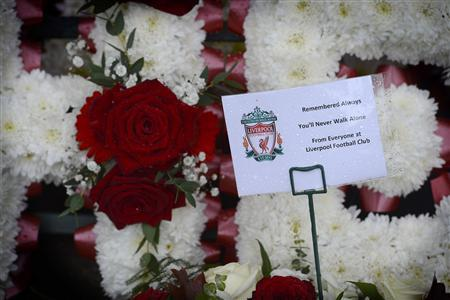 Flowers laid at a memorial to 96 fans killed at the Hillsborough disaster in 1989 are seen at the Anfield soccer stadium in Liverpool, northern England September 12, 2012. REUTERS/Nigel Roddis