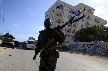 A Somali government soldier patrols the scene of an explosion in the capital of Mogadishu September 12, 2012. Somalia's al Shabaab rebels carried out a bomb attack on Wednesday that targeted a Mogadishu hotel where the president and Kenya's visiting foreign minister were holding a news conference, the group said. REUTERS/Omar Faruk