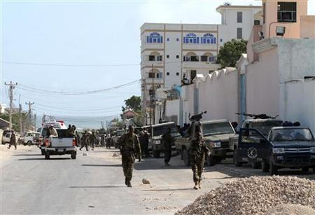 Somali government soldiers patrols the scene of an explosion in the capital of Mogadishu September 12, 2012. REUTERS/Omar Faruk