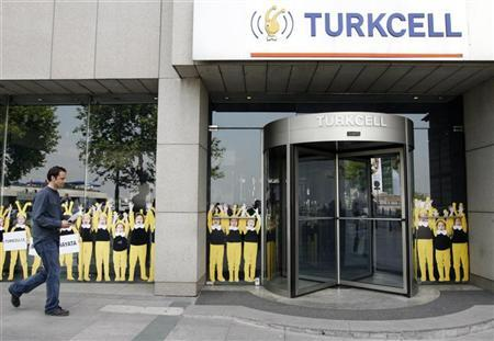 A man walks past the Turkcell head office in Istanbul May 14, 2009. REUTERS/Osman Orsal