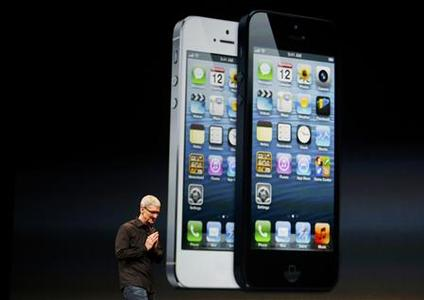 Apple Inc. CEO Tim Cook takes the stage after the introduction of the iPhone 5 during Apple Inc.'s iPhone media event in San Francisco, California September 12, 2012. REUTERS/Beck Diefenbach