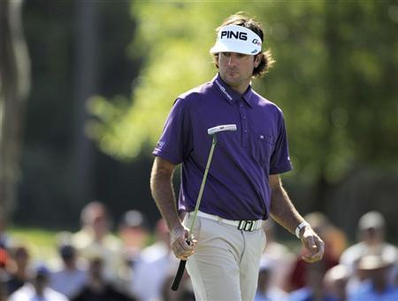 Bubba Watson of the U.S. reacts after his putt on the 17th green during second round play in the Arnold Palmer Invitational PGA golf tournament in Orlando, Florida March 23, 2012. REUTERS/David Manning