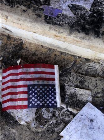 A U.S. flag is seen at the U.S. consulate, which was attacked and set on fire by gunmen yesterday, in Benghazi September 12, 2012. REUTERS/Esam Al-Fetori