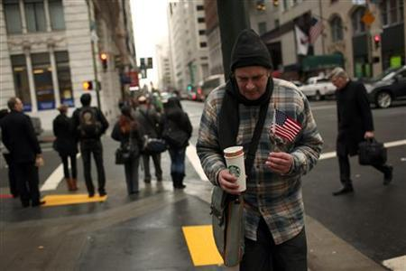 A homeless man begs for money in the Financial District in San Francisco, California March 28, 2012. REUTERS/Robert Galbraith
