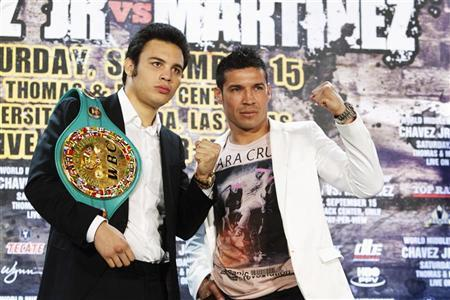 Undefeated WBC middleweight champion Julio Cesar Chavez Jr. (L) of Mexico and Sergio Martinez of Argentina pose during a news conference at the Wynn Las Vegas Resort in Las Vegas, Nevada July 11, 2012. REUTERS/Las Vegas Sun/Steve Marcus