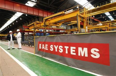 Workmen stand in the BAE Systems' Govan shipyard in Glasgow, Scotland May 26, 2011. REUTERS/David Moir