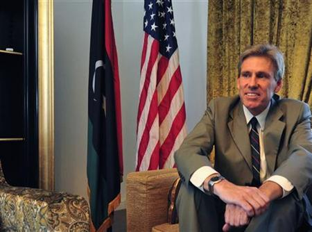 Christopher Stevens, the U.S. ambassador to Libya, smiles at his home in Tripoli June 28, 2012. REUTERS/Esam Al-Fetori