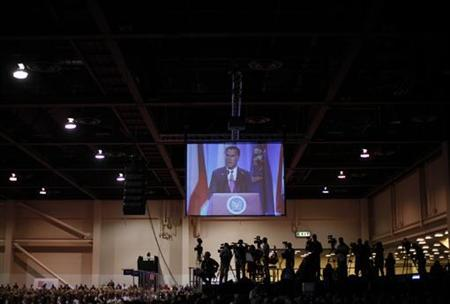 U.S. Republican presidential nominee and former Massachusetts Governor Mitt Romney is projected onto a screen as he addresses the National Guard Association's convention in Reno, Nevada September 11, 2012. REUTERS/Jim Young