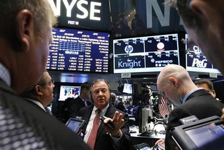 Traders gather at the Barclays Capital post that trades Knight Capital on the floor of the New York Stock Exchange, August 6, 2012. REUTERS/Brendan McDermid