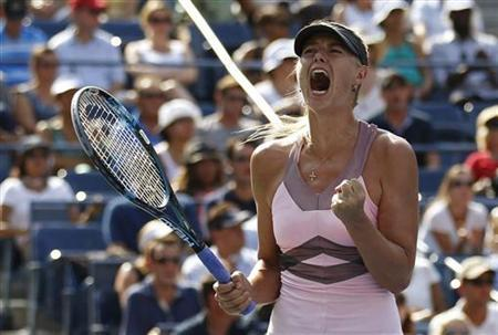 Maria Sharapova of Russia celebrates a point against Victoria Azarenka of Belarus during their women's semifinals match at the U.S. Open tennis tournament in New York September 7, 2012. REUTERS/Adam Hunger