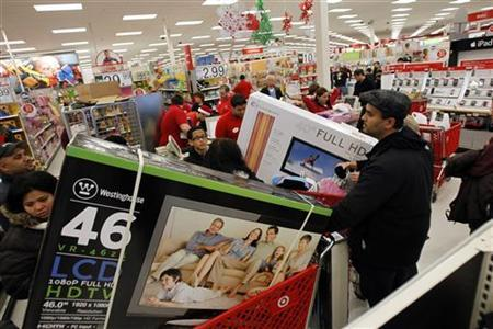 Customers wait in line at the electronics department of a Target store on the shopping day dubbed ''Black Friday'' in Torrington, Connecticut November 25, 2011. REUTERS/Jessica Rinaldi