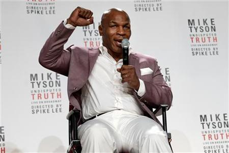 Former heavyweight champion Mike Tyson gestures as he talks about the Broadway debut of his one-man show ''Mike Tyson: Undisputed Truth'' during a news conference in New York, June 18, 2012. REUTERS/Keith Bedford