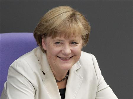 German Chancellor Angela Merkel smiles after addressing a session of the Bundestag, German lower house of parliament, at the Reichstag in Berlin September 12, 2012. REUTERS/Tobias Schwarz