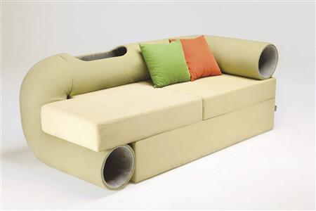 A ''Cat Tunnel Sofa'' is seen in this picture taken by designer Seungji Mun and made available to Reuters in Seoul September 13, 2012. A Korean designer may have the answer with his ''Cat Tunnel Sofa,'' an ingenious combination of human sofa and tubular tunnels for a cat to clamber through while its owner relaxes. The sofa combines modern industrial type design with a bent tube running from the floor in one corner to the arm rest in the other for cats to play in. There's a slot cut in the tube at the rear of the sofa for cats to poke their head through. REUTERS/Seungji Mun/Handout