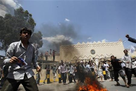 Protesters gather outside the U.S. embassy in Sanaa September 13, 2012. Hundreds of Yemeni demonstrators stormed the U.S. embassy in Sanaa on Thursday in protest against a film they consider blasphemous to Islam, and security guards tried to hold them off by firing into the air. Yemen's embassy in Washington said no casualties were reported when the protesters stormed the U.S. embassy compound in Sanaa on Thursday. REUTERS/Khaled Abdullah