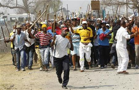 Miners arrive for a march at Rustenburg in South Africa's North West Province, September 13, 2012. REUTERS/Siphiwe Sibeko