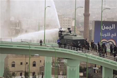 Riot police fire water canons during protests near the U.S. embassy in Sanaa September 13, 2012. REUTERS/Mohamed al-Sayaghi
