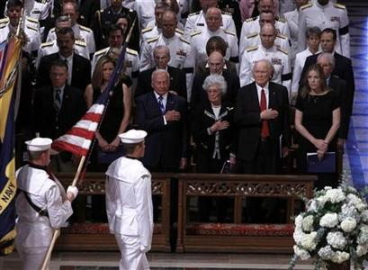 Christina Korp (2nd L), astronaut Buzz Aldrin (3rd L), astronaut John Glenn (2nd R), his wife Annie Glenn, and singer Diana Krall (R) watch an honor guard pass during a tribute to U.S. astronaut Neil Armstrong during a service at the National Cathedral in Washington September 13, 2012. REUTERS/Gary Cameron