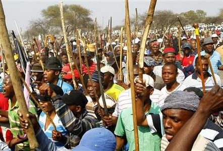 Miners gather for a march in Rustenburg in South Africa's North West Province, September 13, 2012. The leader of a major protest by South African platinum miners called on Thursday for a national strike in the sector, deepening an industrial crisis that is evolving into the biggest threat to the ruling ANC since it came to power in 1994. The wave of labour unrest in Africa's biggest economy has spiralled beyond the control of the government and unions into a grass-roots rebellion by black South Africans who have seen little improvement in their lives since apartheid ended 18 years ago. REUTERS/Siphiwe Sibeko