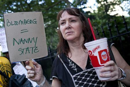 Andrea Hebert of New York protests the proposed ''soda-ban,'' that New York City Mayor Michael R. Bloomberg has suggested, outside City Hall in New York in this file photo taken July 9, 2012. REUTERS/Andrew Burton/Files