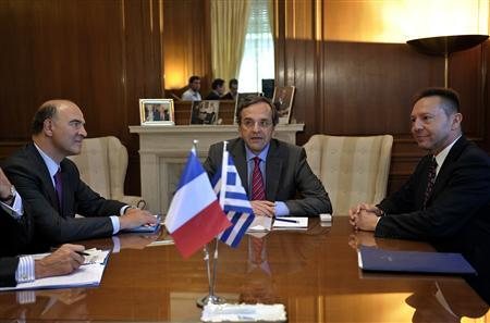 France's Finance Minister Pierre Moscovici (L) meets his Greek counterpart Yannis Stournaras (R) and Greece's Prime Minister Antonis Samaras in Athens September 13, 2012. REUTERS/Aris Messinis/Pool