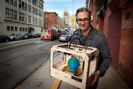 Bre Pettis, co-founder and CEO of Makerbot Industries LLC, is pictured in front of Makerbot Industries LLC manufacturing location, the Botcave, with a three-dimensional printer 'The Replicator' in Brooklyn, New York, in this undated handout photograph. REUTERS/Makerbot Industries LLC/Handout