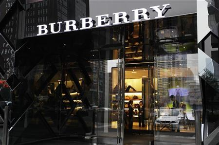 Saleswomen wait for customers in a Burberry shop in Beijing, July 11, 2012. REUTERS/Jason Lee