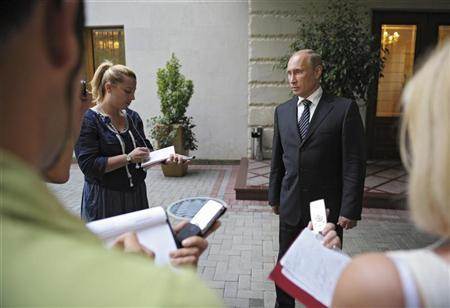 Russian President Vladimir Putin speaks to journalists at the Bocharov Ruchei state residence in Sochi September 13, 2012. REUTERS/Alexsey Druginyn/Ria Novosti/Pool