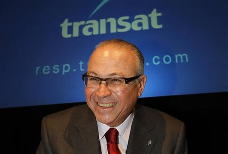 Transat A.T. Inc. president and CEO Jean-Marc Eustache smiles at the company's annual shareholders meeting in Montreal, March 10, 2011. REUTERS/Shaun Best